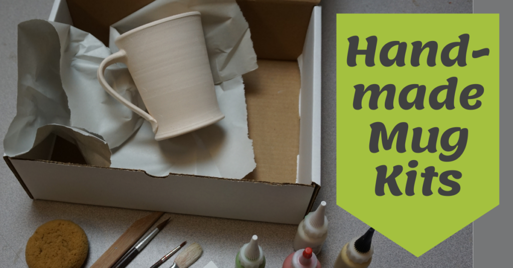 A view of the Handmade Mug Kit with a bisque-fired mug ready to decorate, bottles of glaze, brushes and tools.