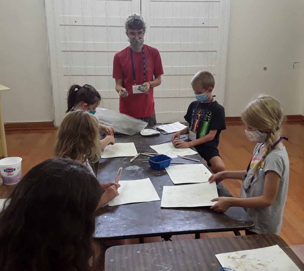 Chip Wagner teaching Summer Art Campers a project.
