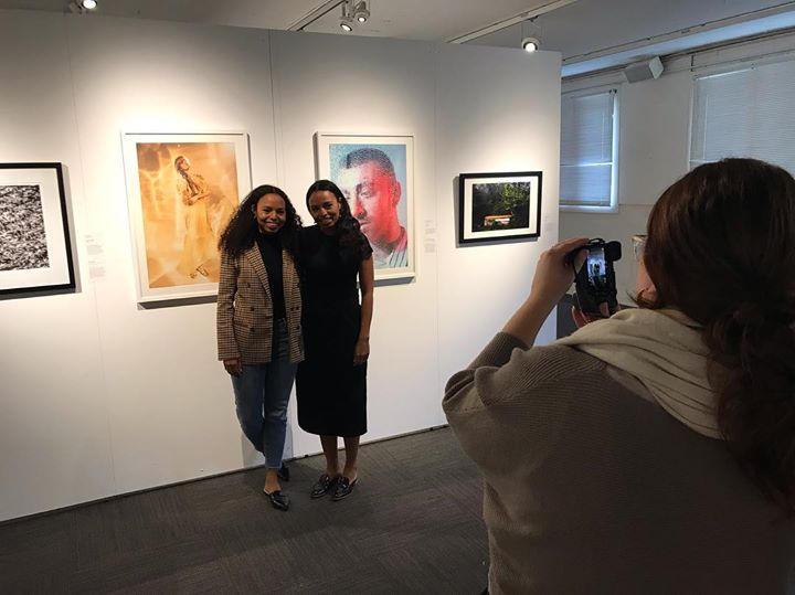 Exhibits Director, Holly Ittel photographs Katherine & Mariel Tyler in front of their award winning images.   #wideopenexcellenceinphotography #dairybarnartscenter #athensohio #oualumni #oualumniawardwinners #sony